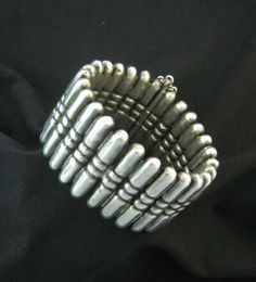 Vintage sterling silver 'Bullet' bracelet (c.1940s) by silversmith and designer Hector Aguilar. Made in Taxco, Mexico. via Silver Huntress