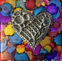 Alcohol Ink Tiles with Metal Embossing               We combined alcohol ink…