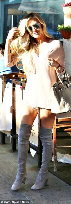 Leggy lady:Former Miss Ireland Claudine showed off her sensational figure in her daring outfit, teaming tiny shorts with a pair of thigh-high boots