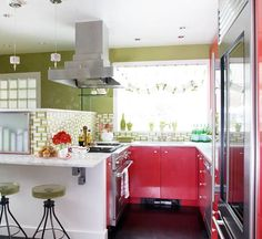 A Contemporary Take ~ Opposites on the color wheel, red and green contrast beautifully in this contemporary kitchen. Each color helps the other shine a little brighter. Together they enhance the exuberant personality of a room filled with hard edges, shiny textures, and playful patterns. White marble countertops and white woodwork offer neutral resting spaces for the eye.