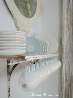 use an old shutter as a plate rack, attach shutter to brackets on wall. use cup hooks underneath to hold cups/mugs and the plates fit in the shutter slats