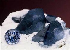 Fine crystals of benitoite on a matrix of white natrolite with a faceted benitoite from the Benitoite Gem mine, San Benito, County, California. Jeff Scovil photo.