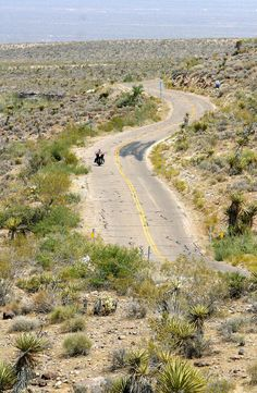 A lone motorcycle rider travels on histo