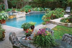 Poolside Container Garden - 17 Sparkling Pools - Southernliving. Whether you're dining al fresco or dangling your feet in the water, this pool draws you into a lush canvas of textures, colors, and flowers.