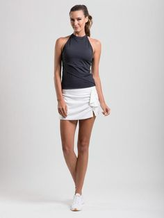 High performance tennis skort with built in pockets and precision ruffle detailing. Built-in shorts Washer & dryer friendly Stash storage pocket Feminine ruffles Secure zipper back pocket Sport this on the court or course Tennis Skort, Get The Look, Navy And White, White Shorts, Basic Tank Top, Feminine, Game, Tank Tops, Collection