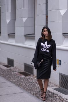 Storm takes the sports luxe trend to a new level by pairing her Adidas sweater with a body con skirt for a polished look. Now this is how to do street chic. Sweater: Adidas, Skirt: Zara, Sandals: Mango, Bag: Chloe, Mais