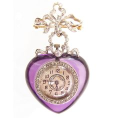 A diamond set pendant watch in the form of a carved amethyst heart, suspended from an ornate diamond set bow. Mounted in 18ct yellow gold and platinum. English. 1905.