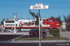 "https://flic.kr/p/CDwYy5 | Railroad Avenue is on the other side of town | A westbound Santa Fe train roars through Hanford, California on a summer morning.  Since the Southern Pacific was usually the first railroad into towns in California, the road along the SP was ""Railroad Avenue,"" while the street paralleling ATSF was usually ""Santa Fe Avenue."""