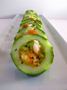 Smoked Salmon, Avocado Cucumber Sushi Recipe♥  For the Shrimp, Smoked Salmon, Avocado 3 oz smoked salmon, diced 10 large shrimp, cooked and diced 1 small, ripe avocado, mashed black sesame seeds for garnish Eel sauce for drizzling using a melon baller, scoop out the seeds all the way through each halved cucumber, creating a tunnel.  This will be your sushi base.