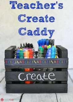 Pen Caddy Teacher's Gift DIY—Cute DIY gift using crates and ball jars for teachers, students, crafters, or just for yourself! (Tip: Glue material or ribbon around each jar to prevent clanging.) | DIY Teacher's Create Caddy by Melissa Mitchell on Aug. 25, 2014 from Sippy Cup Mom