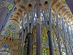 The magical interior of the Sagrada Familia is staggering. The ceiling vaults high above you with light filtering through the column branches just like a woodland.