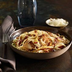 Despite their names and their common family, the Jerusalem artichoke and the globe artichoke aren't at all alike—one is a tuber, the other a thistle. Yet, flavorwise, they relate perfectly in this pasta dish. Add some slivers of red onion, lots of garlic, a kick of red pepper flakes, a squeeze of lemon juice, and a shower of thinly sliced fresh mint and you have a boldly seasoned pasta dish worthy of serving to company yet easy enough for a family meal.