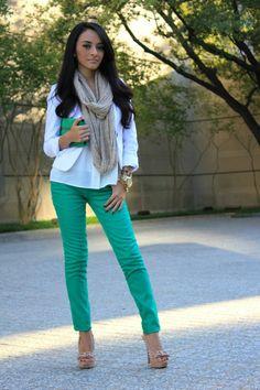 green pants. Tan heels. White top. Gold bling.