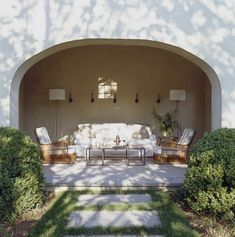 Ina Garten Barn: The covered porch features chic 1920s rattan chairs.