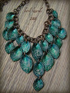 polymer clay bib necklace in turquoise. It looks like titanium! MonaRAEbeads.etsy.com