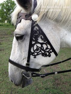 This item is NOT guaranteed for delivery before HALLOWEEN.  These leather bridles are carved by hand. They feature a buckle at the poll for