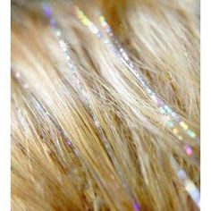 Hair Tinsel? HAH! Save money by simply working at any Hallmark store at Christmastime. The stuff breeds like rabbits there...   @Michelle Flage @Kirsten McClendon