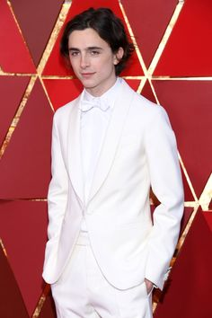 Timothée Chalamet wore a full ivory Berluti ensemble featuring an ivory collar jacket and pants in Japanese wool, an white Cotton bow tie and shirt, Jaeger LeCoultre watch, Berluti black glazed leather and Ankle boots to the 2018 Oscars Beautiful Boys, Beautiful Person, Gorgeous Men, Handsome Celebrities, Handsome Actors, Timmy T, Andrew Christian, Big Sean, Perfect Man