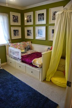 Gallery wall and hemnes day bed with Anthropologie and Pottery Barn bedding with Land of Nod playhouse