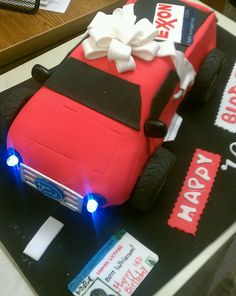 Ben turns 16 and can drive. Cake has real working headlights. Edible drivers license & bow