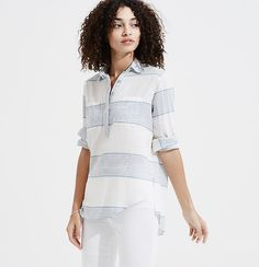 The look of a button down with the ease of a tunic, this slouchy style is an endless essential. Point collar. Long sleeves with button tab. Henley button placket. Patch chest pockets. Back yoke with loop. Shirttail hem.