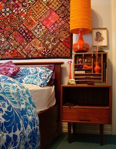 Bohemian style with lovely textile on the wall.