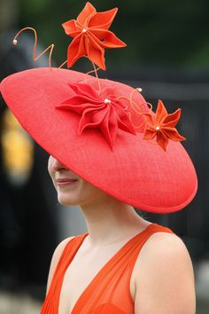A racegoer at Royal Ascot in June 2009.  RoyalAscotHat  VonGiesbrechtJewels  Red Hat Club e1b860eb802