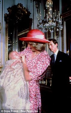 Princess Diana holding Prince William on his Christening day as Charles looks on in 1982.
