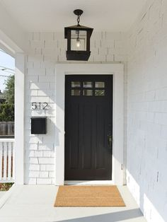 Black Front Door. White Exterior Front Door Paint Color: Sherwin Williams SW Tricorn Black SW 6258 Latex Satin. Love the lantern too!