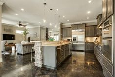 Traditional Kitchen With Crown Molding Island Acid Stained Concrete Flooring Limestone Tile