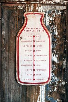 """Add a dash of cheer to your farmhouse décor with this Metal Milk Bottle Sign, which whimsically bears the Recipe for a Healthy Life. The aged, rustic metal gives this inspirational wall art plenty of charm and vintage character. It's one recipe that will surely bring smiles and should be shared for generations to come. 11""""W x 23""""H"""