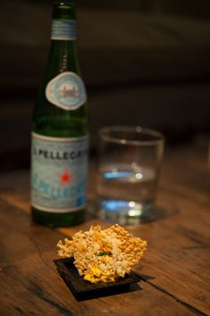 Making a modern interpretation of a classic dish is like covering a great song. This version of Eggplant Parmesan contains eggplant and tomato mousse, topped with Parmesan cheese chips seasoned with lemon. #LiveOffTheMenu #Sanpellegrino