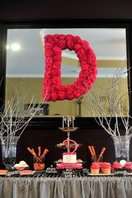 I believe this was made using flower tissue paper and glued onto a foam or cardboard letter. So cute and easy looking.