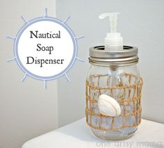 Nautical Soap Dispenser - Make this simple nautical soap dispenser with a mason jar, burlap, and a seashell! http://www.oneartsymama.com/2013/07/diy-nautical-so…