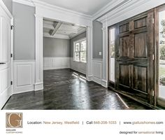 Massive #woodendoor and #Hardwoodflooring create a wonderful contrast with the coffered ceiling. http://www.gialluisihomes.com