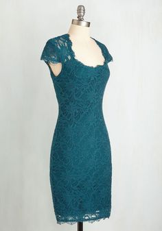 Showcase your stylish sophistication in this snug, teal-green sheath dress! With sheer, dainty cap sleeves, an alluring open back, and a fabulous eyelash lace overlay, this frock boasts unquestionable charm.