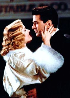Penelope Ann Miller and Alec Baldwin in The Shadow (1994).