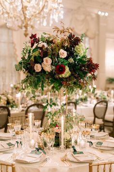 These beautiful, tall centerpieces were designed for a fall wedding at Rosecliff Mansion. Burgundy florals and spilling greens on tall gold stands were accented with glowing candlelight. Gold Wedding Centerpieces, Wedding Flower Arrangements, Wedding Bouquets, Wedding Decorations, Burgundy Floral Centerpieces, Flower Bouquets, Purple Bouquets, Bridesmaid Bouquets, Floral Arrangements