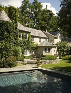 Ivy Covered French Country House..love the dark plaster pool.