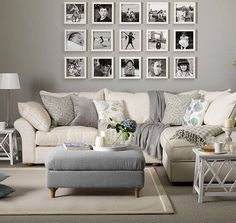 I like the look of the cosy couch and the picture display on the wall.
