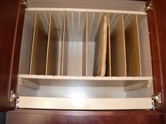Install tray dividers in the cabinet above your refrigerator or oven to make better use of a high space. Beneath the tray divider is a pull ...