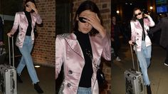 Bella looks weary as she heads to Paris in pink blazer and patchwork jea...