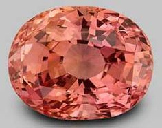 Oval Cut Padparadsha is quite rare. While of the Corundum family, it is Not a sapphire. It is a subtle combination of pink and orange, and it is extremely hard.