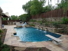 Lagoon style pool that matches the beautiful landscape