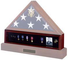 13 Military Flag Displays & Accessories   Pictured here is the flag display, medal display in center, and cremation urn base.