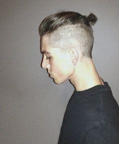 Shaved sides man bun
