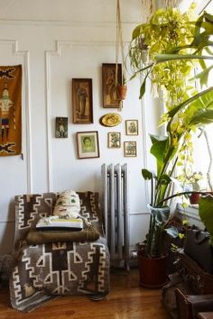 Put pictures on the wall. Throw a couple plants in the mix. (Hannah Metz at Home in Brooklyn)