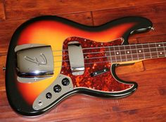 "1964 Fender Jazz Bass, Sunburst, Tortoise Pickguard, Brazilian Rosewood fingerboard with clay dots, Attractively Flamed Maple Neck, ""L"" plate, Both covers, One owner, Exceptionally fine condition, Clean original hard shell case, $CALL"
