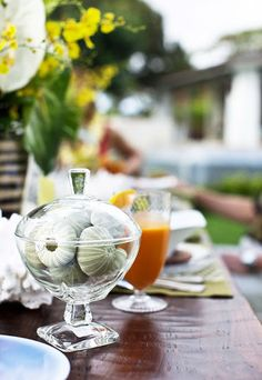 Sea urchins in a pretty footed covered bowl - from CHIC COASTAL LIVING: Honolulu Outdoor Entertaining