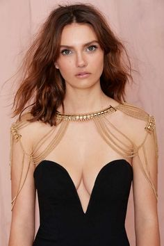 $40 Look gorgeous in this gold shoulder chain featuring thin draped links connected to neck and shoulder.